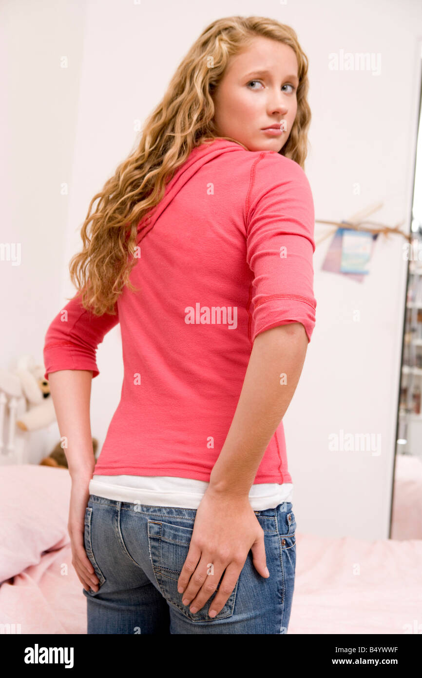 Teenage Girl Worried About The Size Of Her Behind - Stock Image