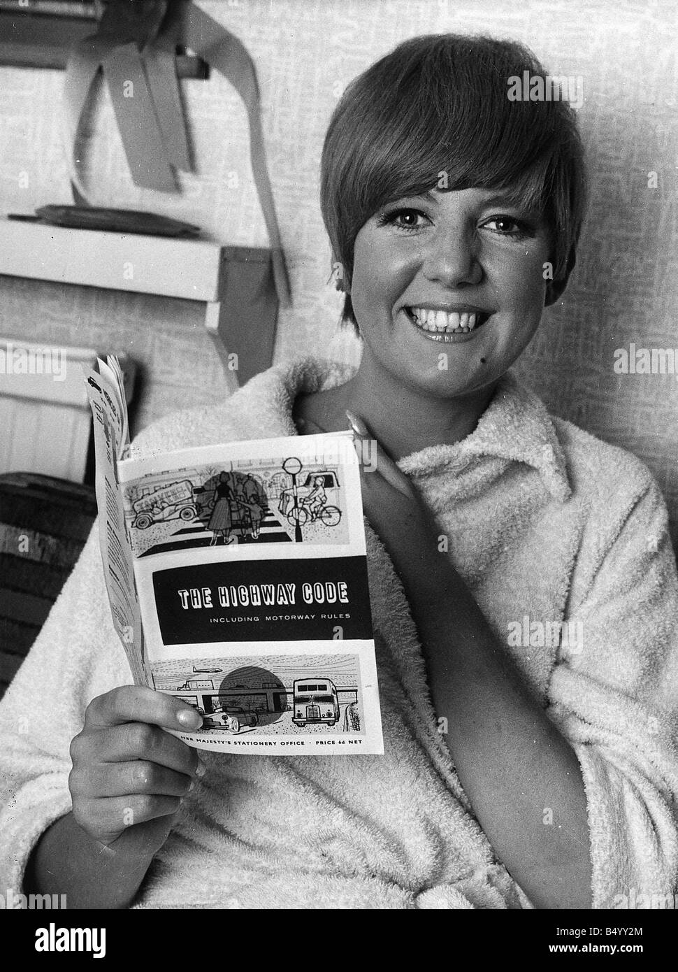 Cilla Black pop singer entertainer reading The Highway Code preparing for her driving test in 1966 - Stock Image