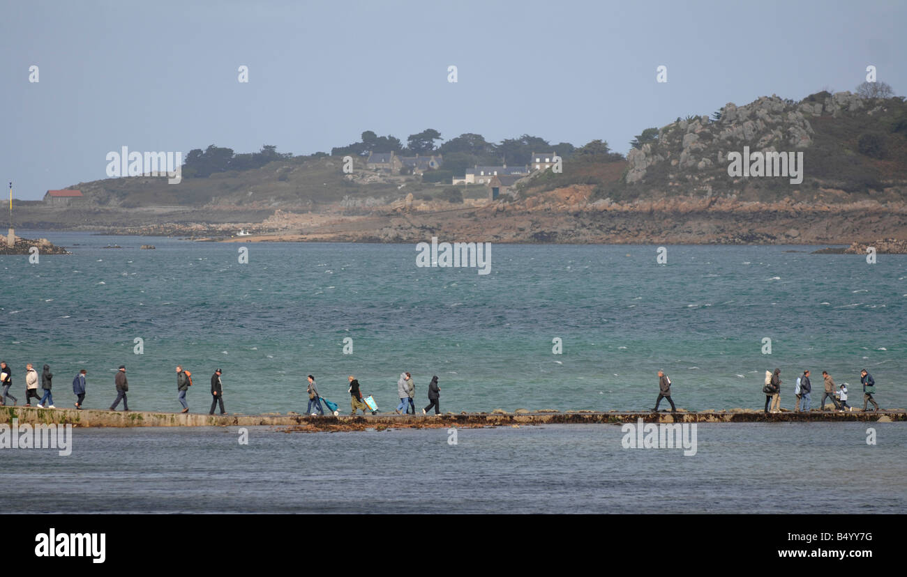 At Point de l Arcouest people walk to the ferry to Ile de Brehat. Stock Photo