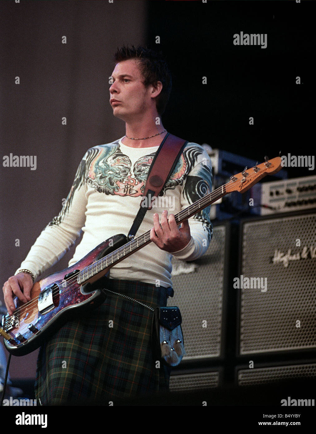 Guitarist from the Stereophinics performing on stage at T in the Park July 1999 wearing a kilt - Stock Image