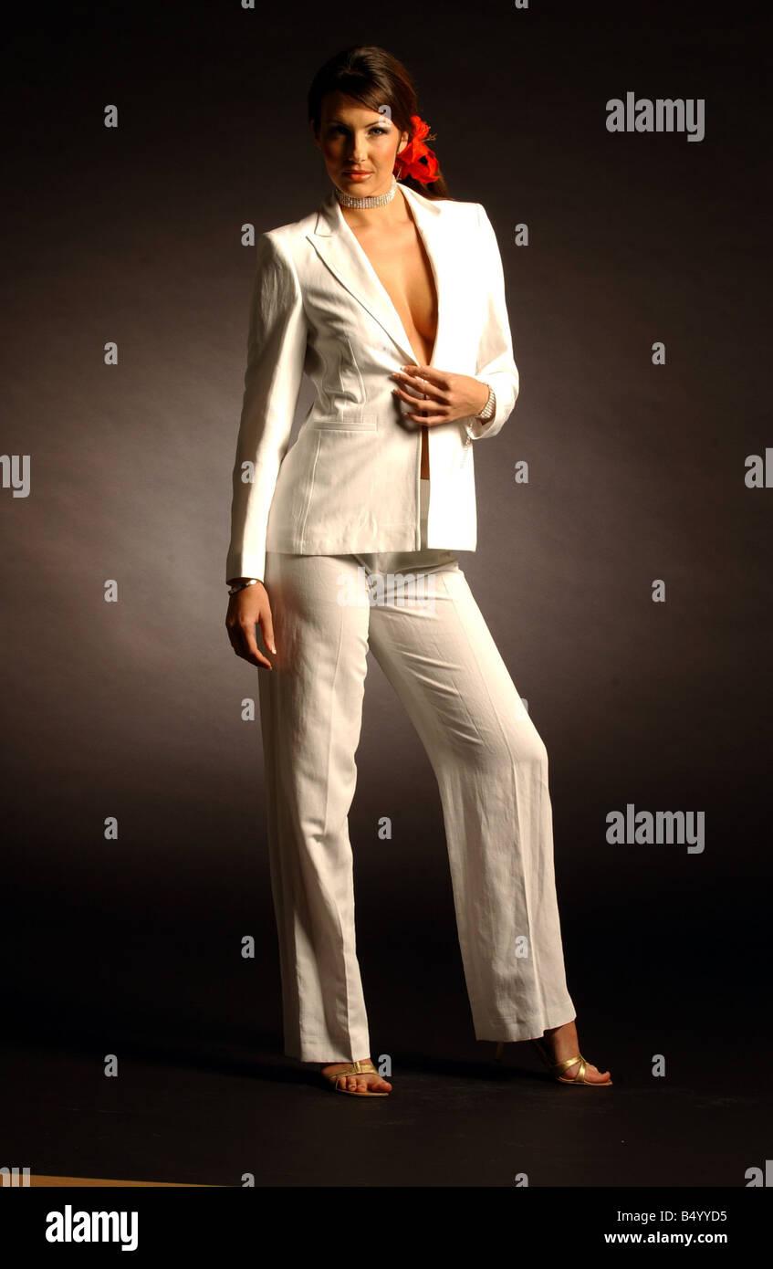 Wedding fashion April 2002 model Julie Hannah wearing a cream white trouser suit jacket trousers - Stock Image