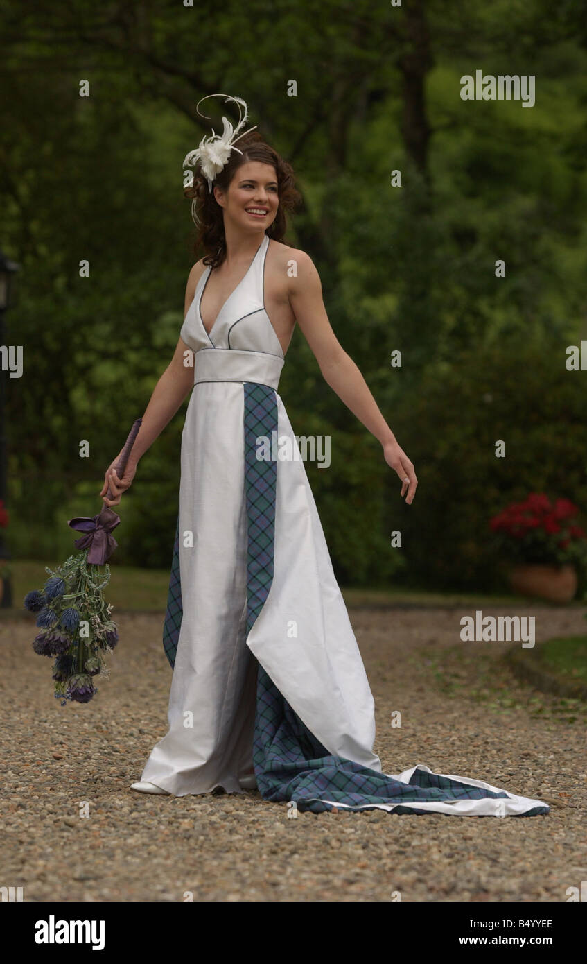 Bridal Fashion feature June 2004 WEDDING DRESS FASHION MODEL GEMMA FORBES MODELLING WEDDING DRESS FROM TOUCH OF - Stock Image