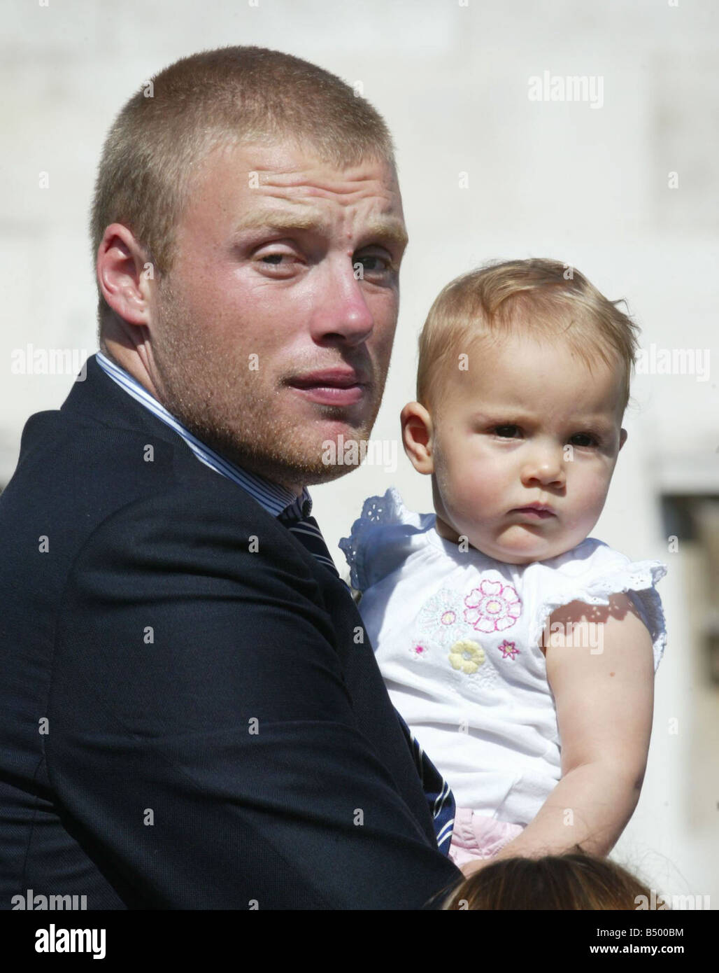 Ashes Celebrations September 2005 Andrew Flintoff on stage with his daughter in Trafalgar square today after winning - Stock Image