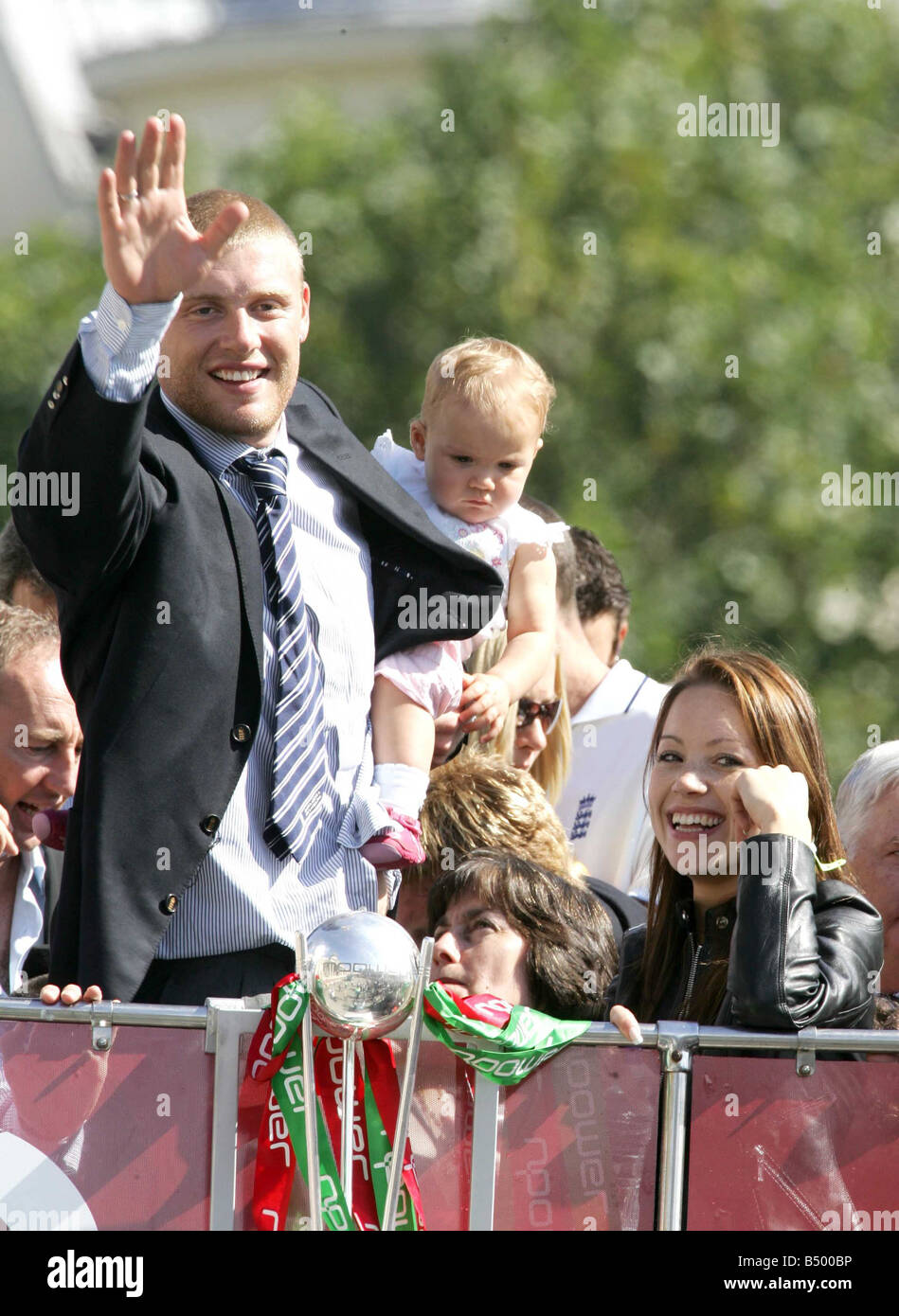 Andrew Flintoff with his baby daughter and his wife Rachel on the bus during England celebrations after winning - Stock Image
