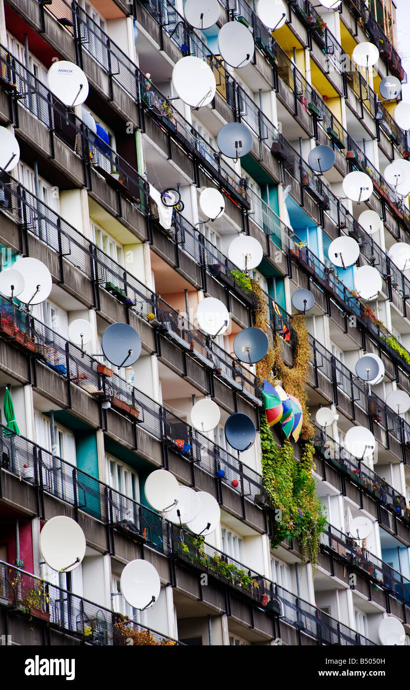 Many satellite dishes fixed to balconies of apartment building built as social housing at Pallasstrasse in Schoneberg Stock Photo