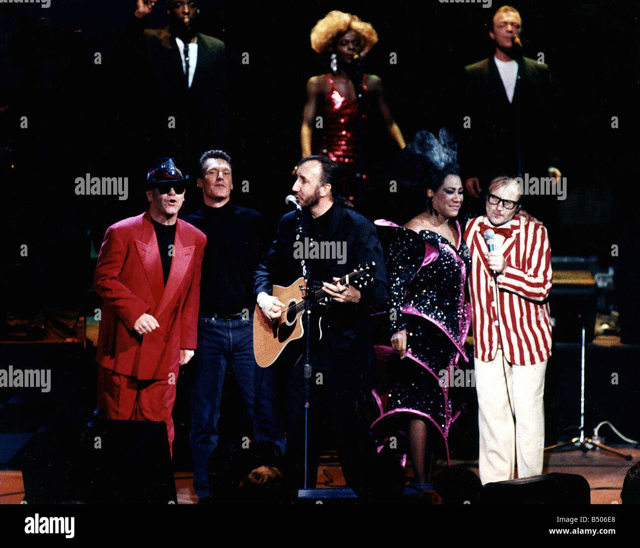 The Who pop group with various singers Elton John singer left in red suit and Steve Winwood 2nd left Pete Townshend - Stock Image
