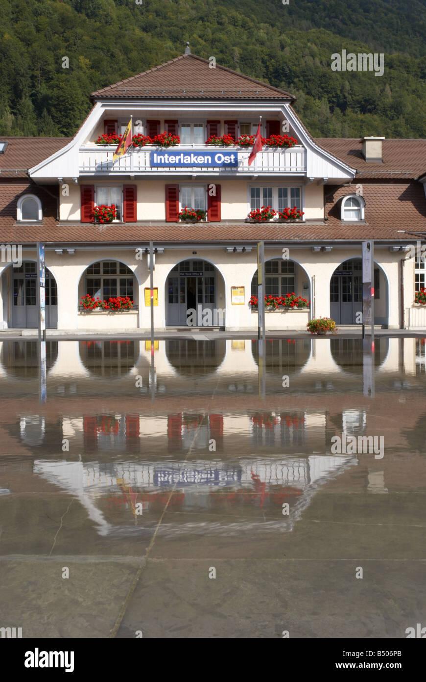 Reflections and Interlaken Ost Railway Station Switzerland - Stock Image