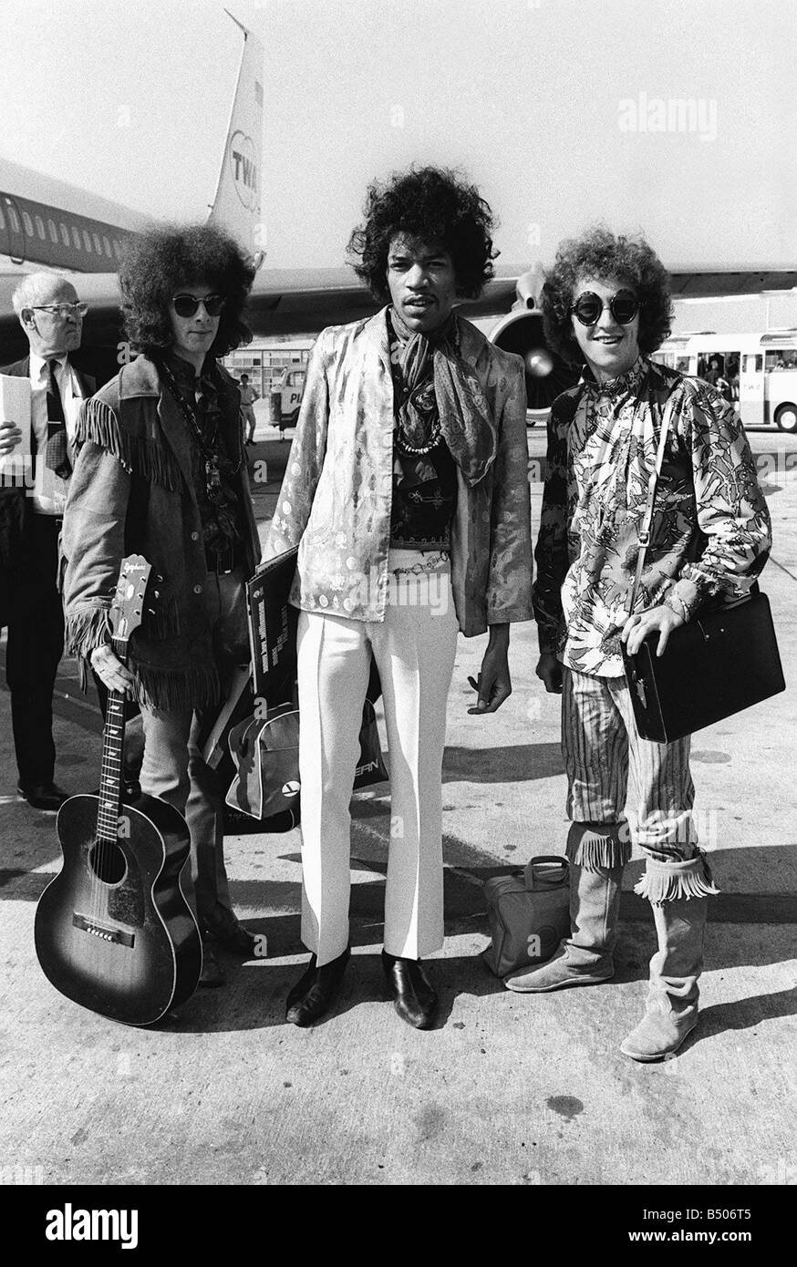 The Jimi Hendrix Experience arriving at Heathrow Airport August 1967 airplane guitar luggage sunglasses - Stock Image
