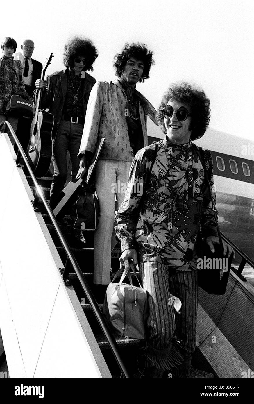 The Jimi Hendrix Experience arriving at LAP August 1967 airplane luggage sunglasses guitar London airport - Stock Image