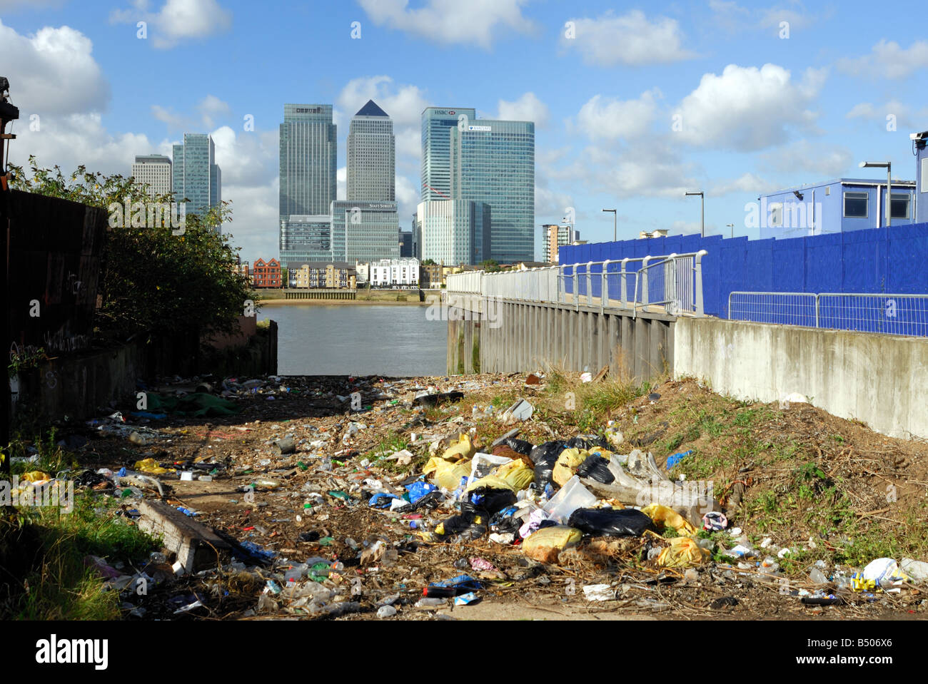 River Thames pollution with Canary Wharf in background London UK - Stock Image