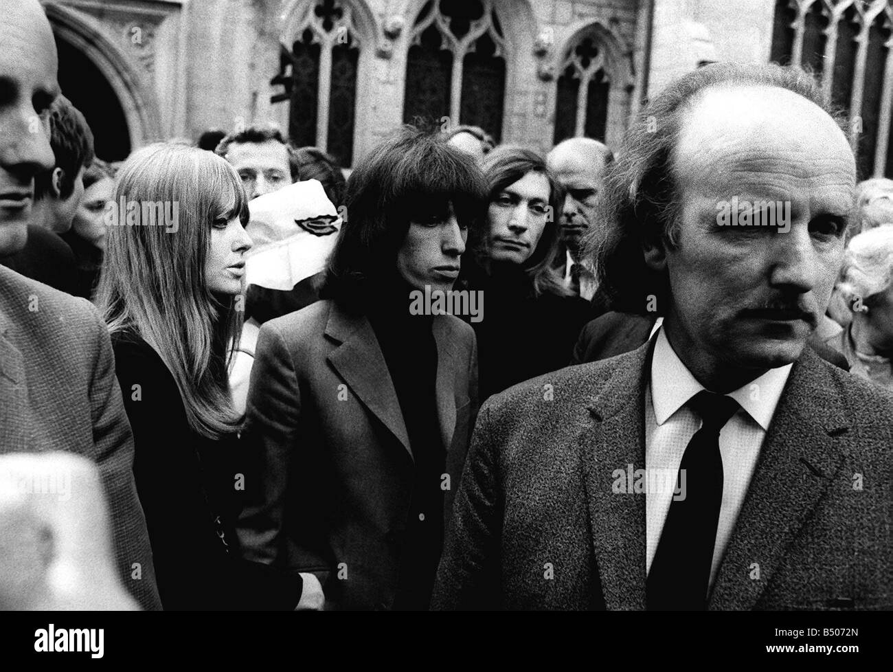 Charlie Watts and Bill Wyman at funeral of Brian Jones 1969 who was a band member of Rolling Stones - Stock Image