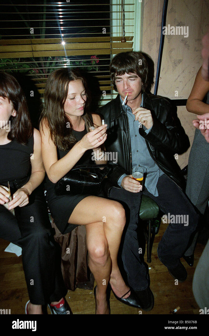 Noel Gallagher Singer October 98 Oasis band member talking to supermodel Kate Moss at the after show party of Steve - Stock Image