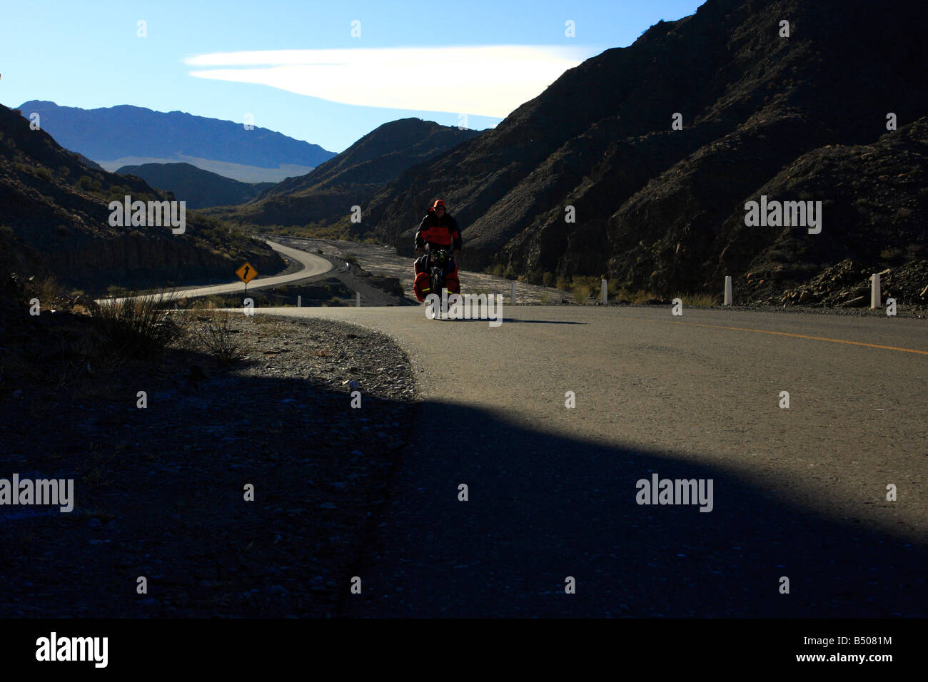 A man is cycling in the Andes San Juan province Argentina - Stock Image