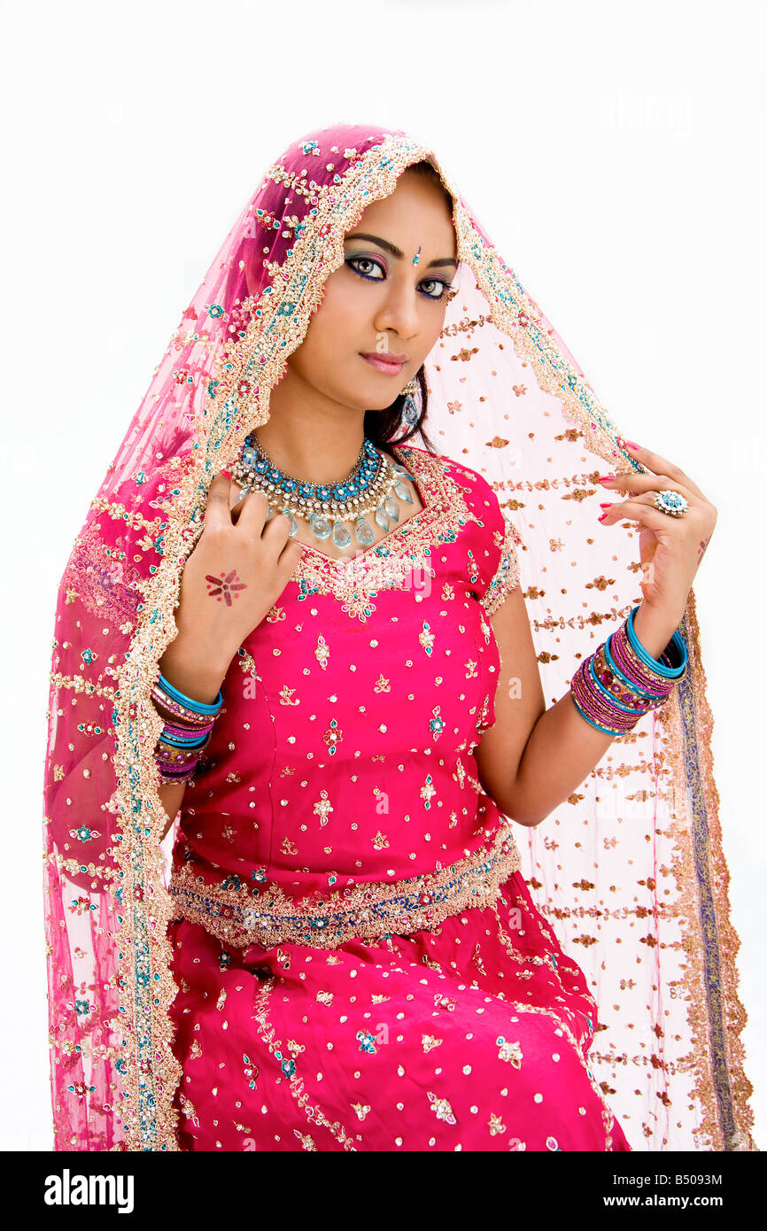 Beautiful Bangali bride in colorful dress and veil isolated Stock Photo