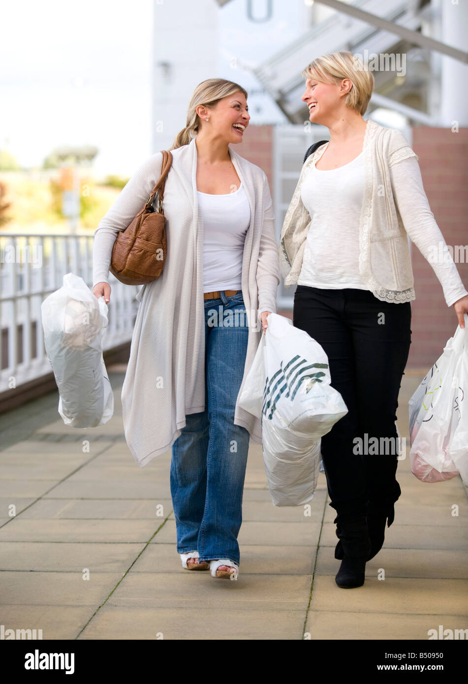Two girls shopping - Stock Image