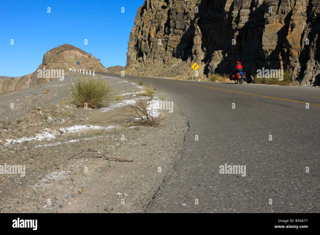 Back view of a man cycling in the Andes San Juan province Argentina - Stock Image