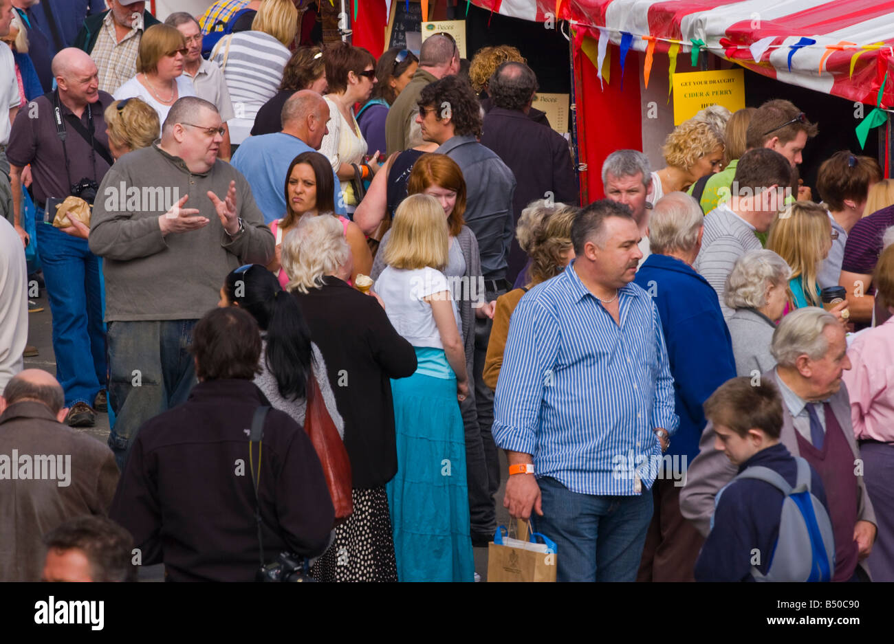 People wander and browse openair stalls at Abergavenny Food Festival Stock Photo