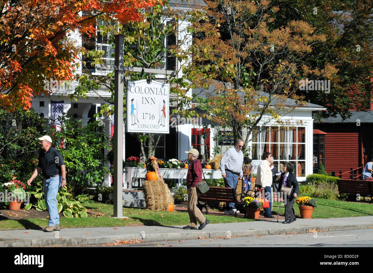 Colonial Inn, circa 1716 in Historic Concord Massachusetts in fall with people, pumpkins, sign and building - Stock Image