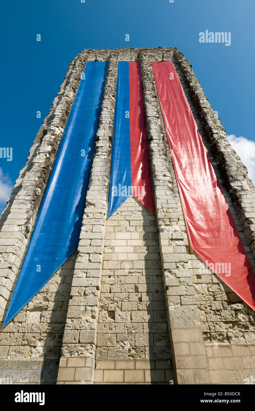 Banner flags hanging from the Tour Carrée (Square Tower), Loudun, Vienne, France. - Stock Image
