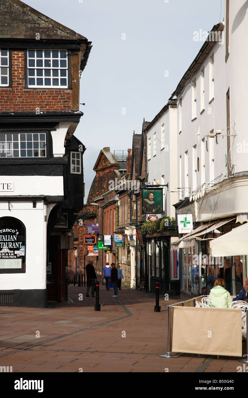 Guildhall museum on the left with shoppers and tourists enjoying lunch and refreshments. Fisher Street, Carlisle, - Stock Image