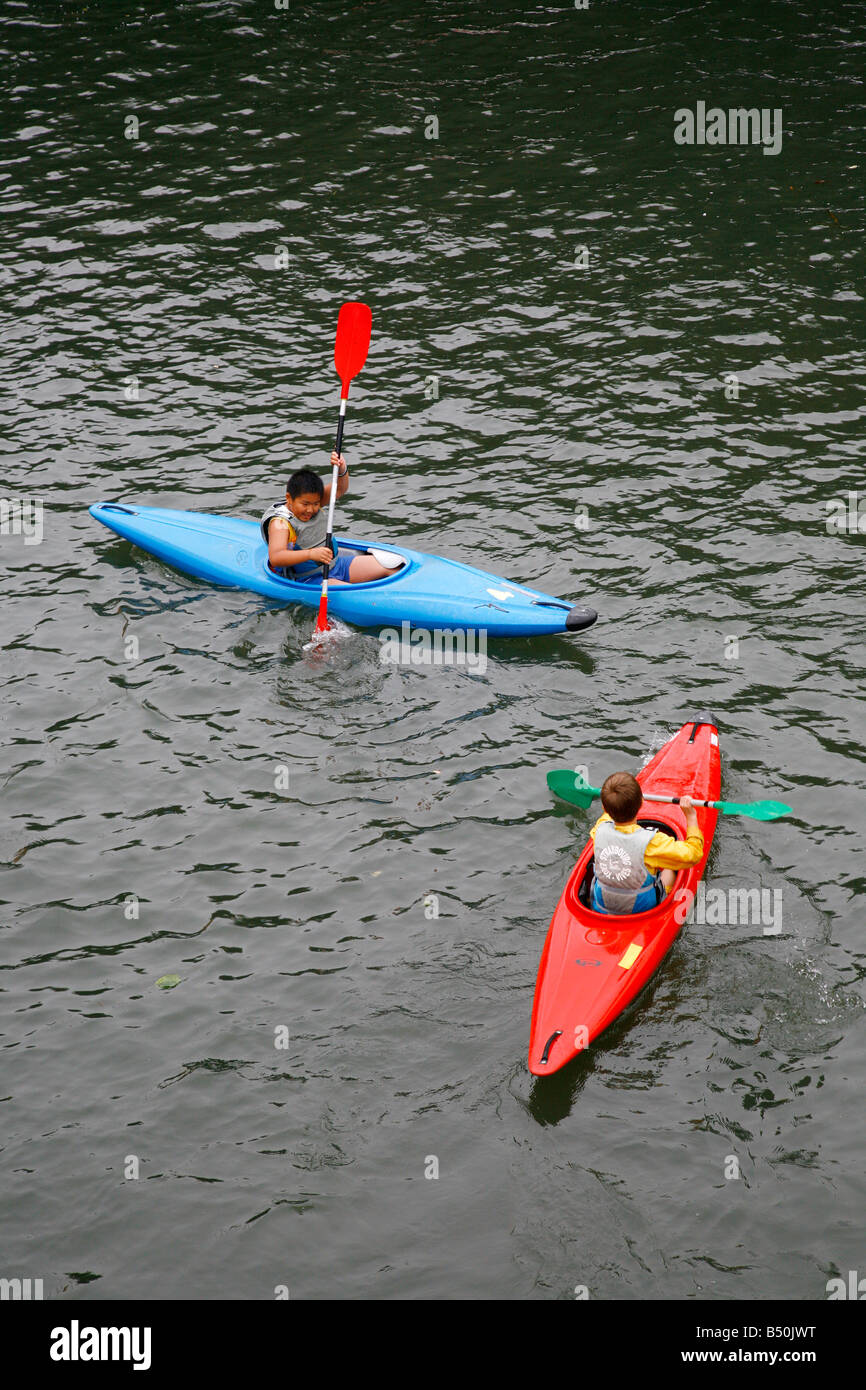 Sep 2008 - childrens using kayaks on the Ill river Strasbourg Alsace France - Stock Image