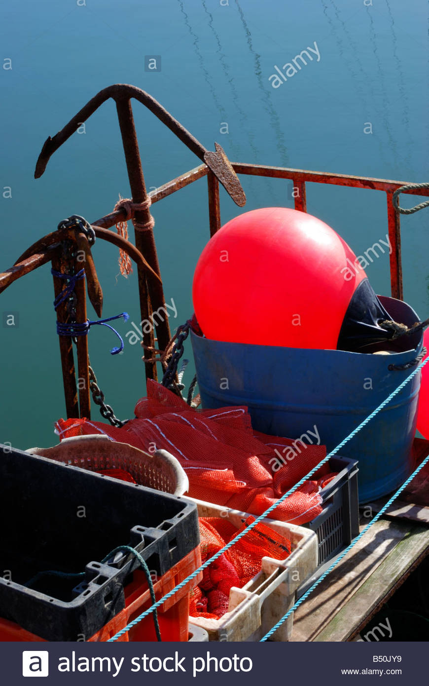 Tackle stored in crates on the back of a fishing boat, Weymouth, Dorset, England, UK Stock Photo