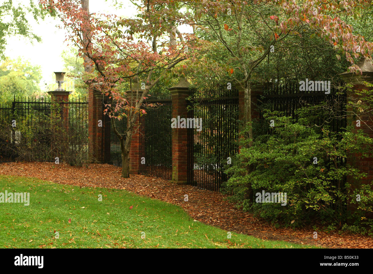 A wrought iron gate in the Fall - Stock Image