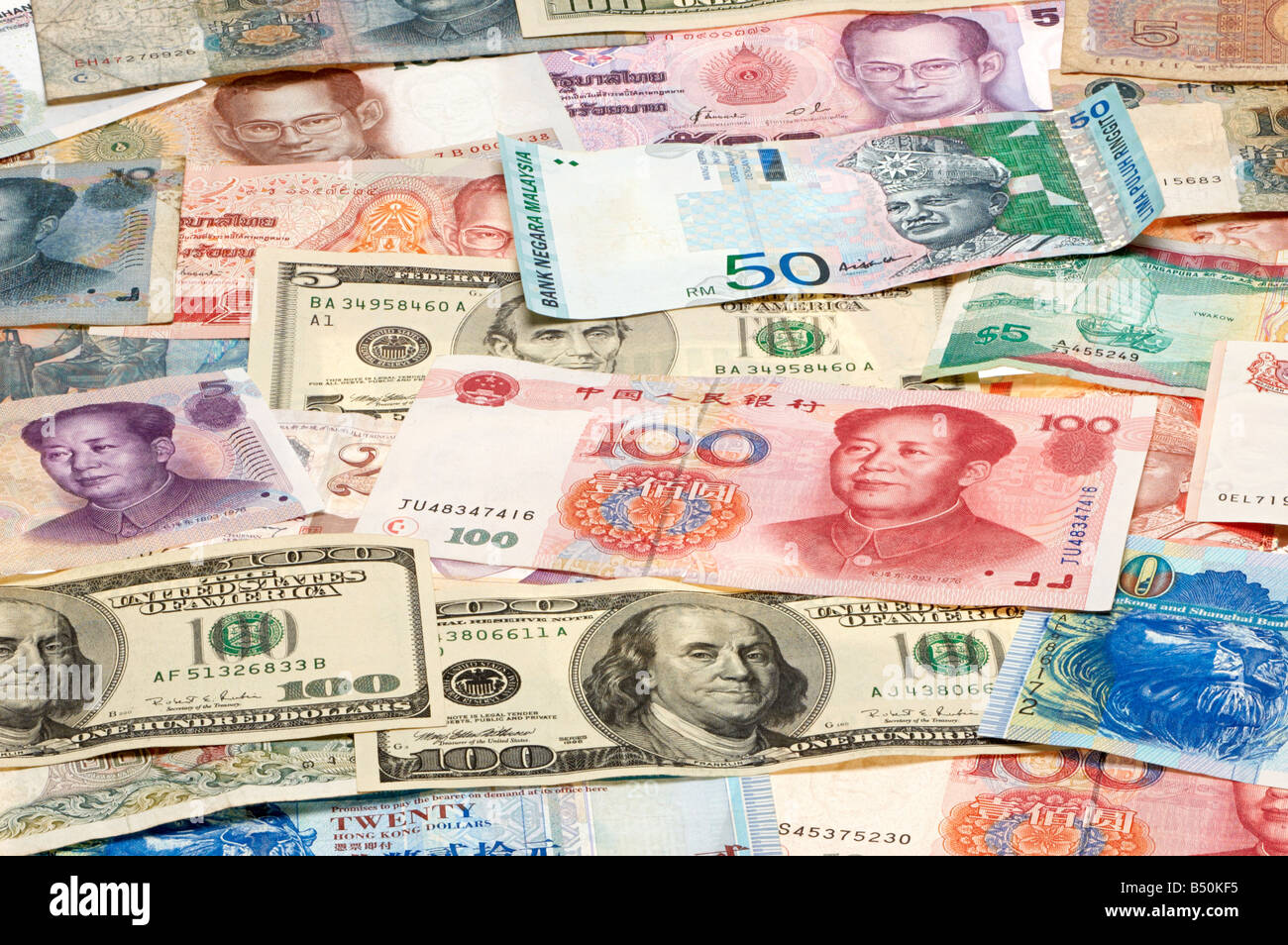 Paper money from various countries such as the USA, China, Malaysia, Singapore, Thailand - Stock Image