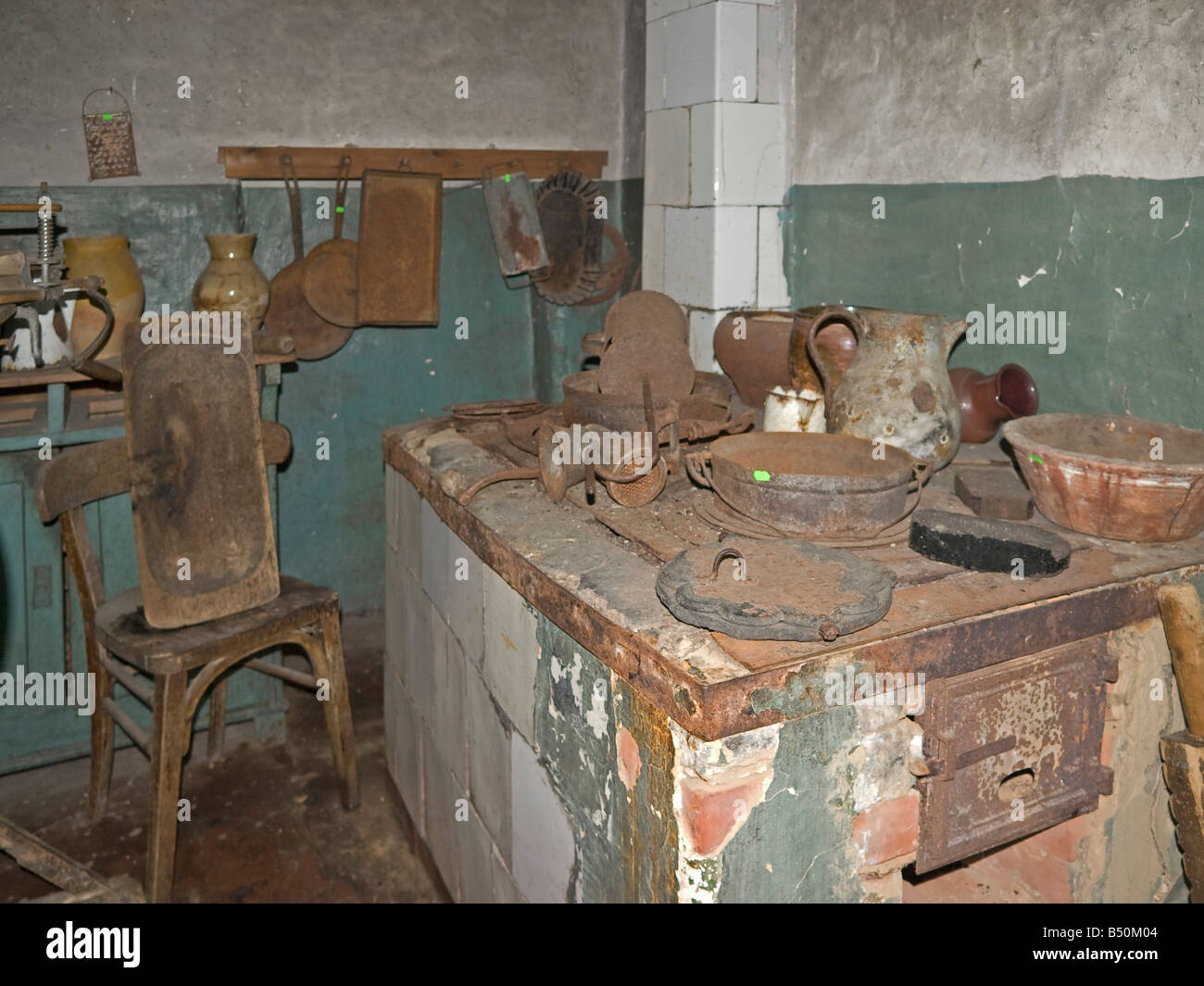 Museum of farmer and fisher with an old kitchen with broken stove near the old town Rusne at the district Klaipeda - Stock Image