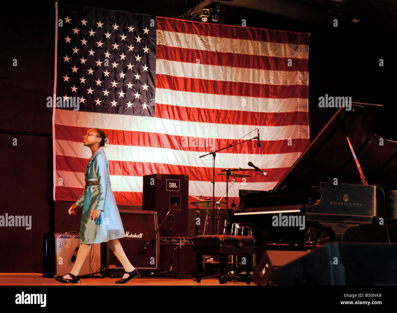Obama Rally, with Sheimyrah Mighty, young singer, walking across stage in front of large American flag, NY, USA, - Stock Image