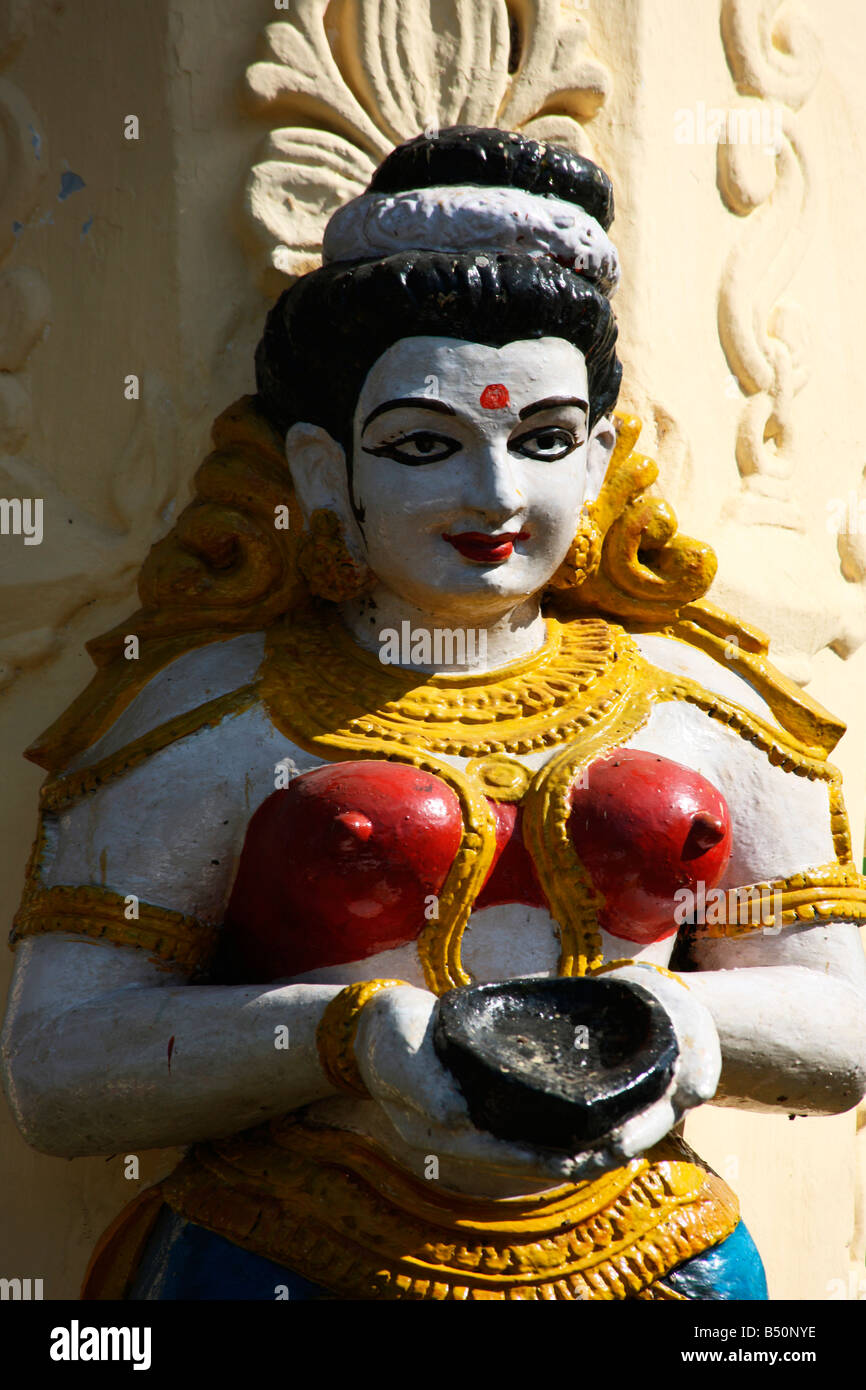 A statue of a woman holding earthen lamp - Stock Image