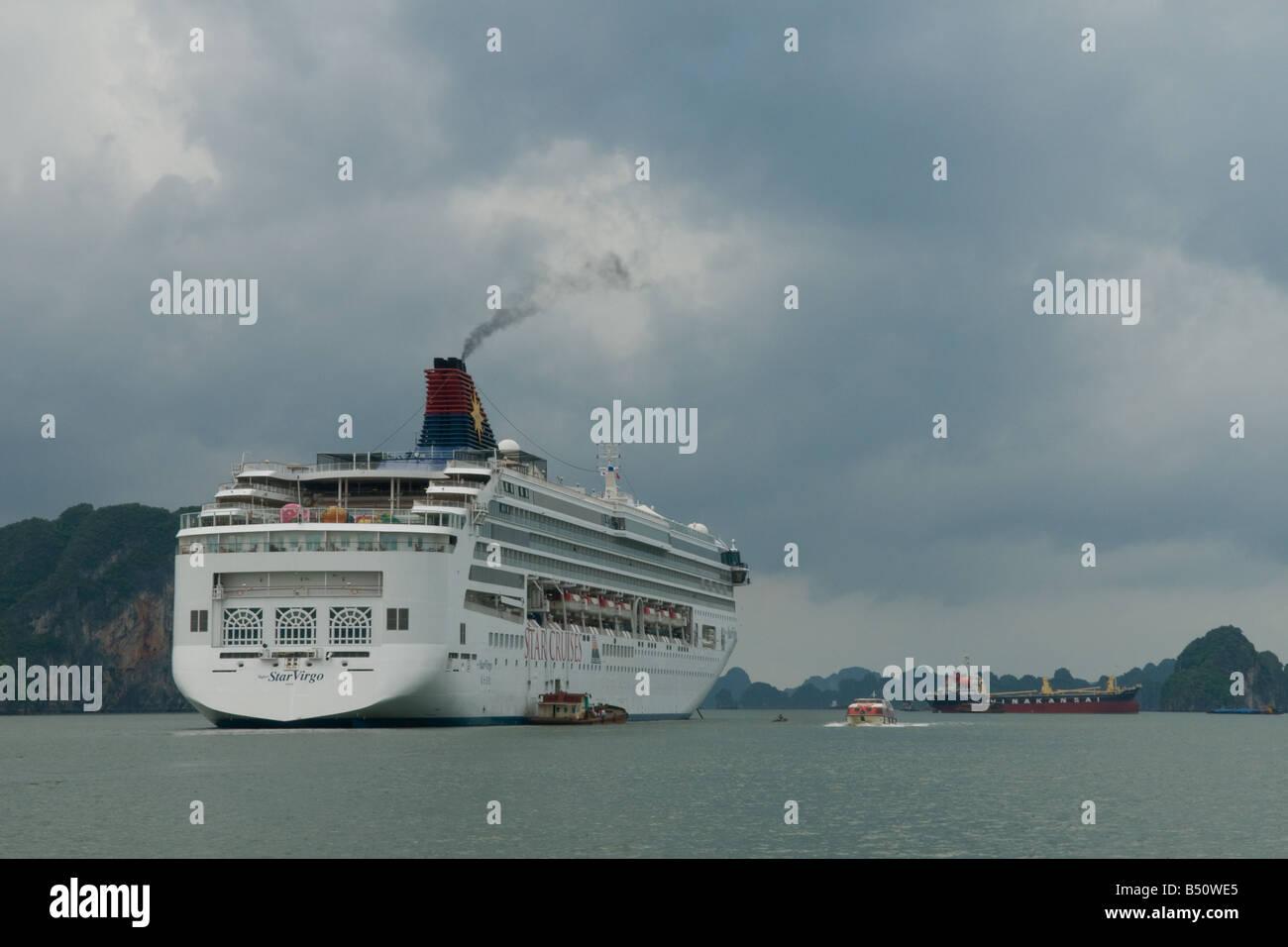 Large passenger cruise ship ('Super Star Virgo' from 'Star Cruises') in Halong Bay, Vietnam - Stock Image