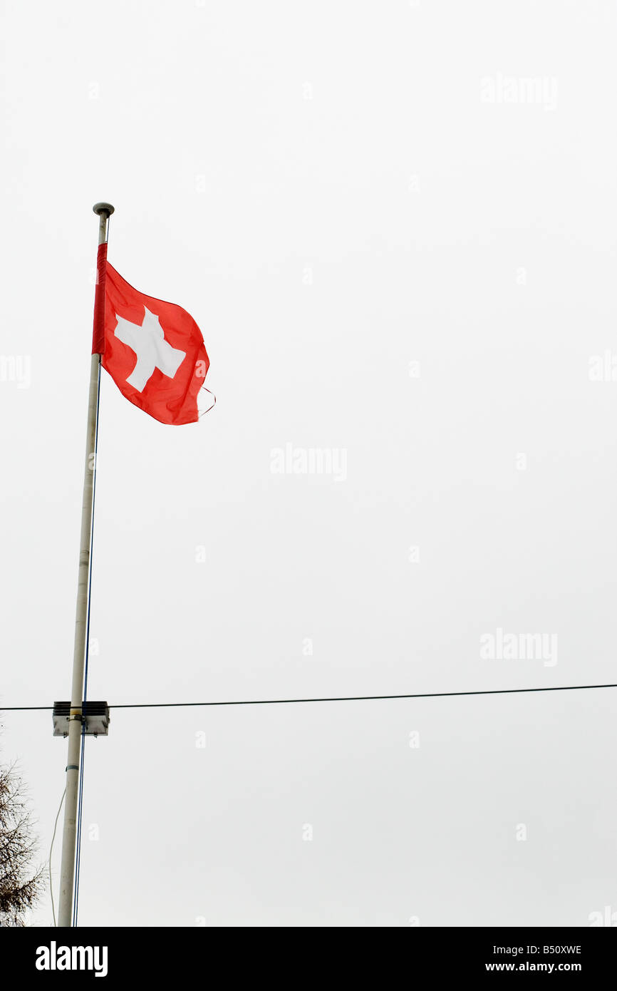 Low angle view of a Swiss flag Switzerland - Stock Image