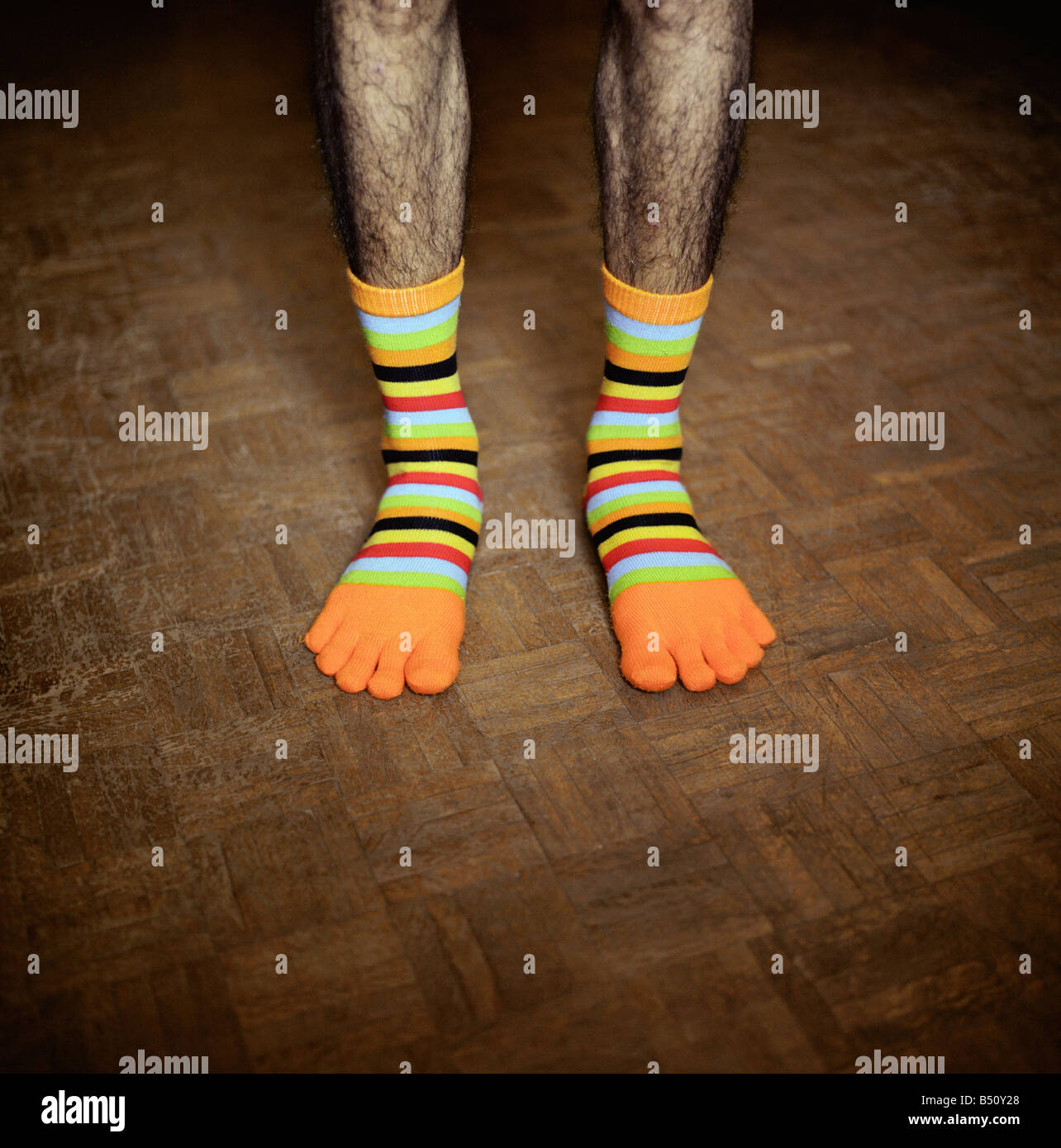 Low section view of a man wearing funny socks - Stock Image