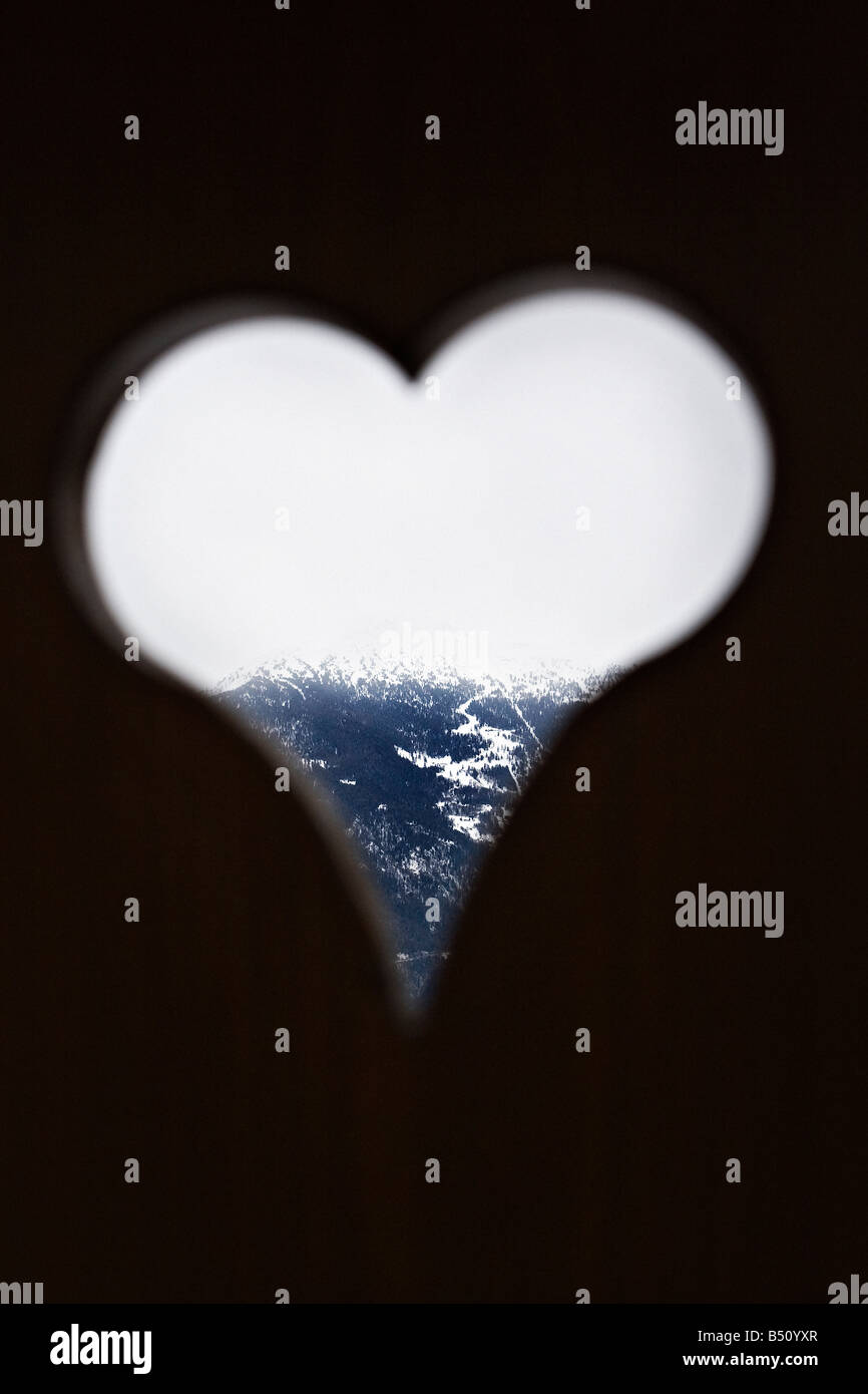 Mountain viewed through a heart shape windowan Alps Switzerland - Stock Image