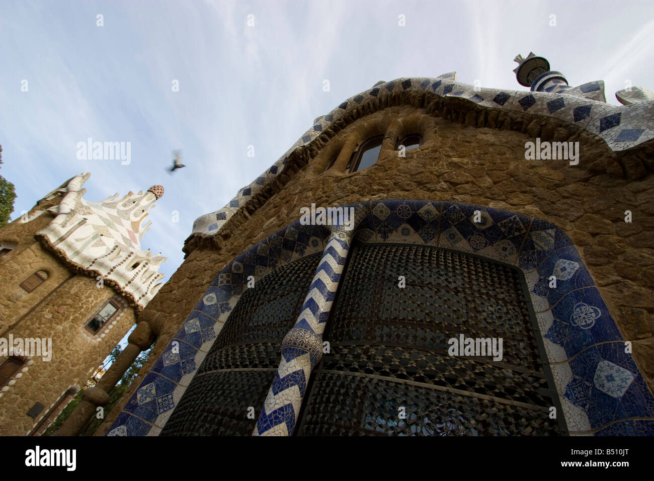 Detail of building at entrance to Parc Guell parkland area commisioned by Count Guell to Goudi Barcelona Spain - Stock Image