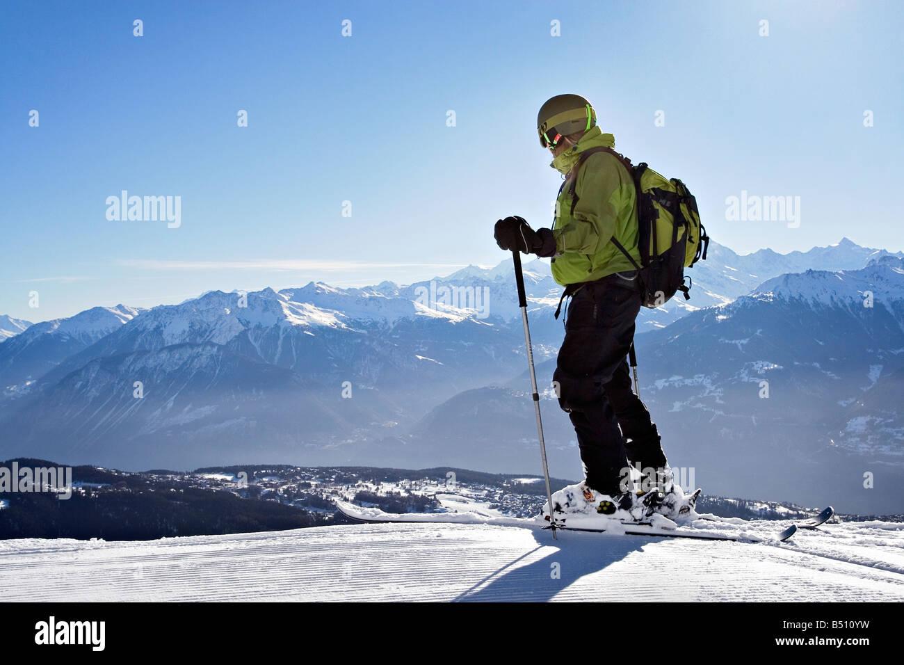 Young man skiingan Alps Switzerland - Stock Image