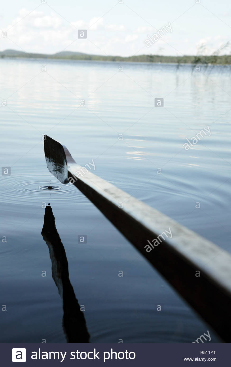 Oar of a row boat in a lake Finland - Stock Image