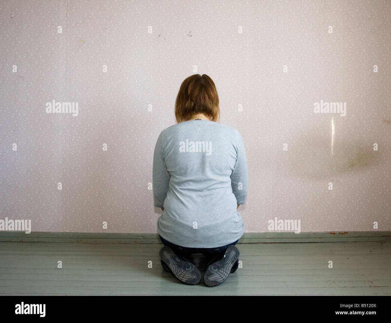 Rear view of a mid adult woman meditating - Stock Image