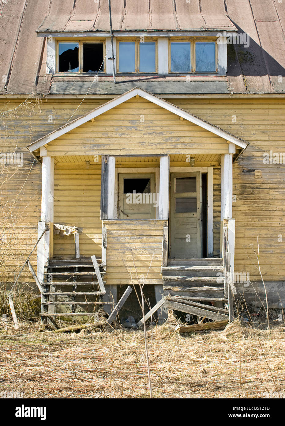Facade of an abandoned house - Stock Image