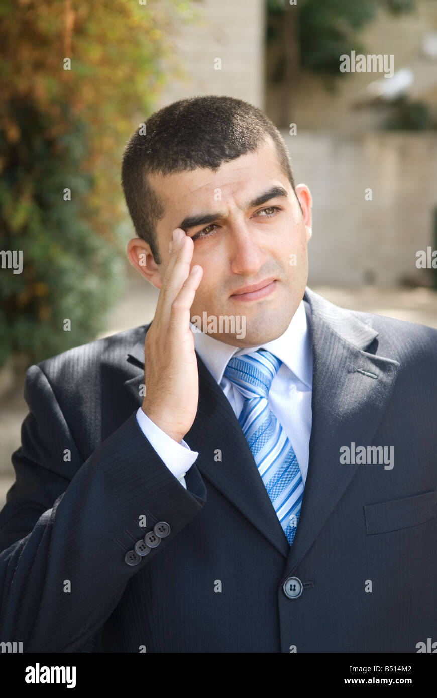 Business man head in hand trying to remember - Stock Image