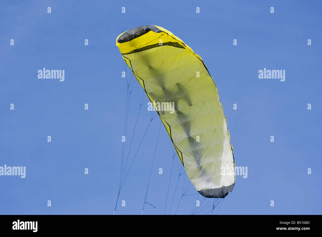 yellow foil kite - four liner with a lot of power - Stock Image