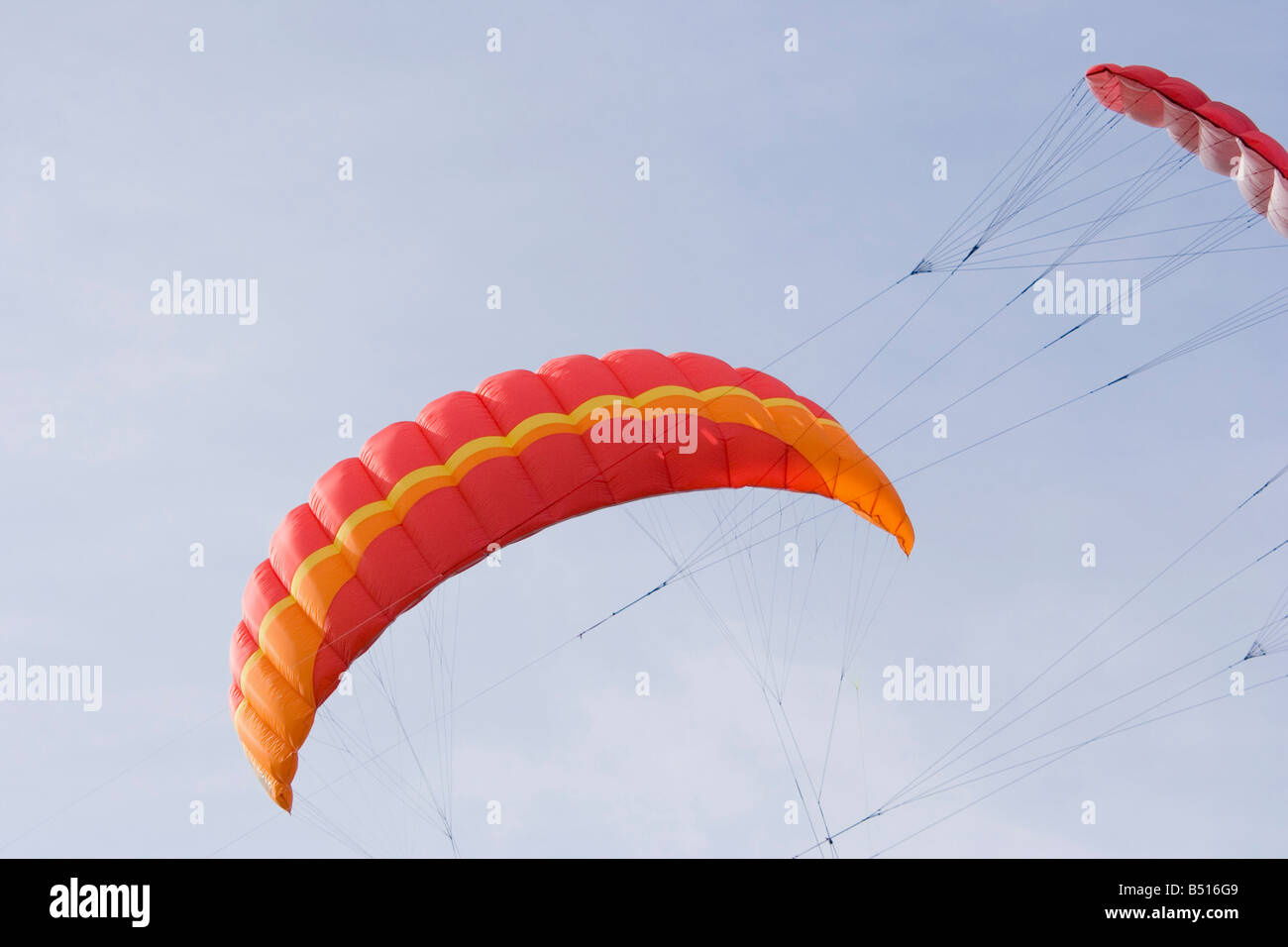 two power kites on the sky - nearly a collision - Stock Image