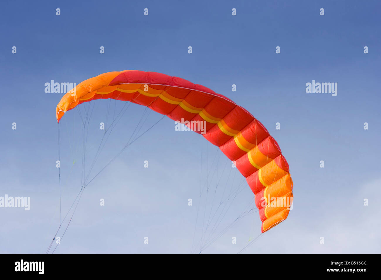 red power kite - this kite is a de-power foil and is used for buggying, land boarding or snowkiting - Stock Image