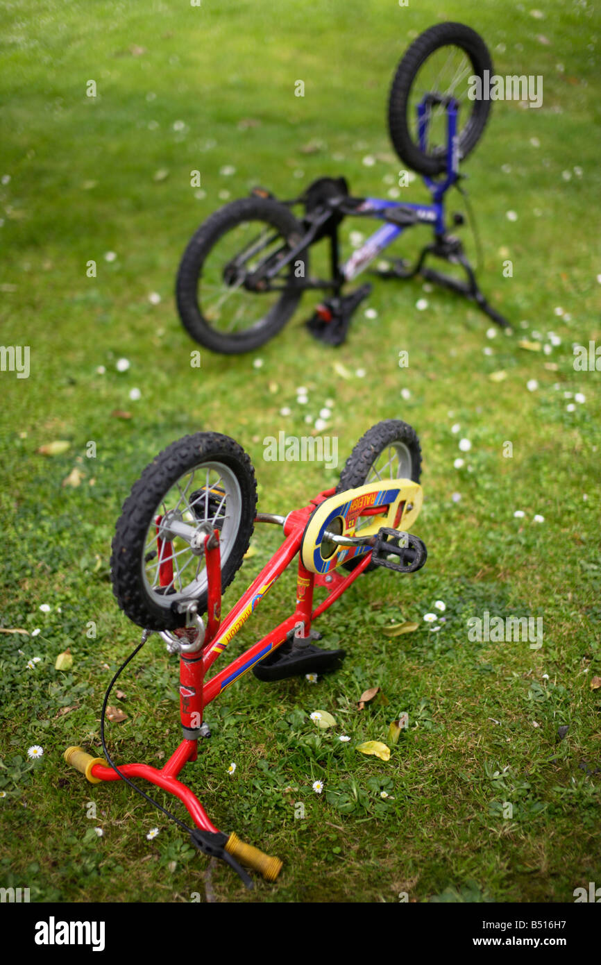 Bike maintenance Childrens bicycles upside down - Stock Image