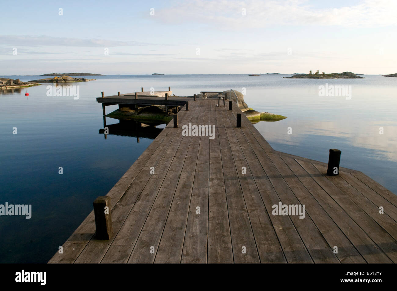 Wooden jetty in private bay, on the island of Västerö, Rödlöga in the Stockholm archipelago - Stock Image