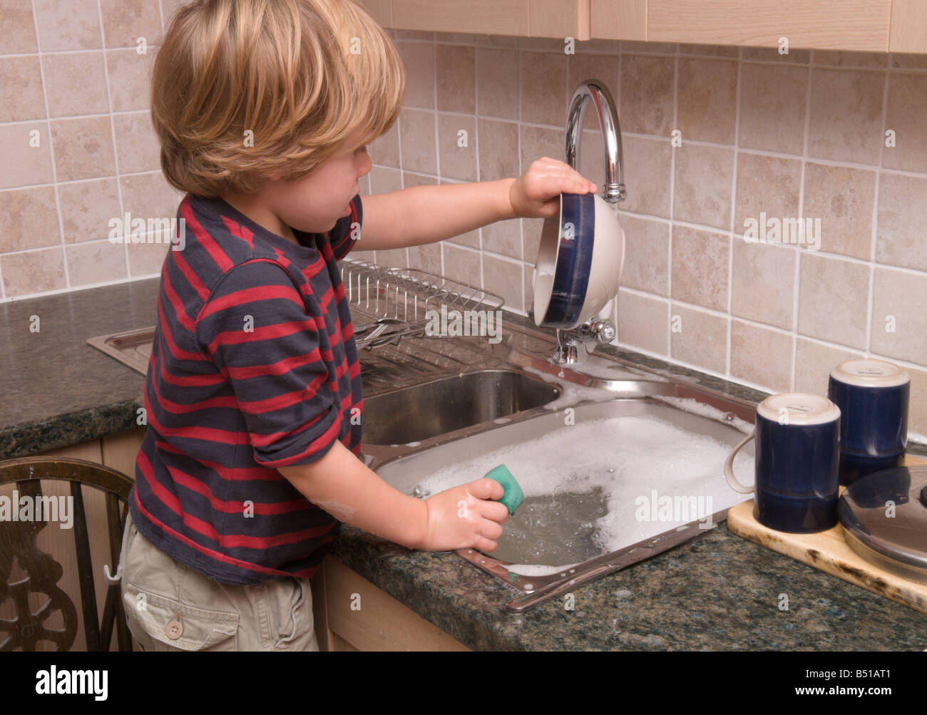Toddler Boy Child Washingup Kitchen Sink Doing The Dishes With Hot - Hot water for kitchen sink