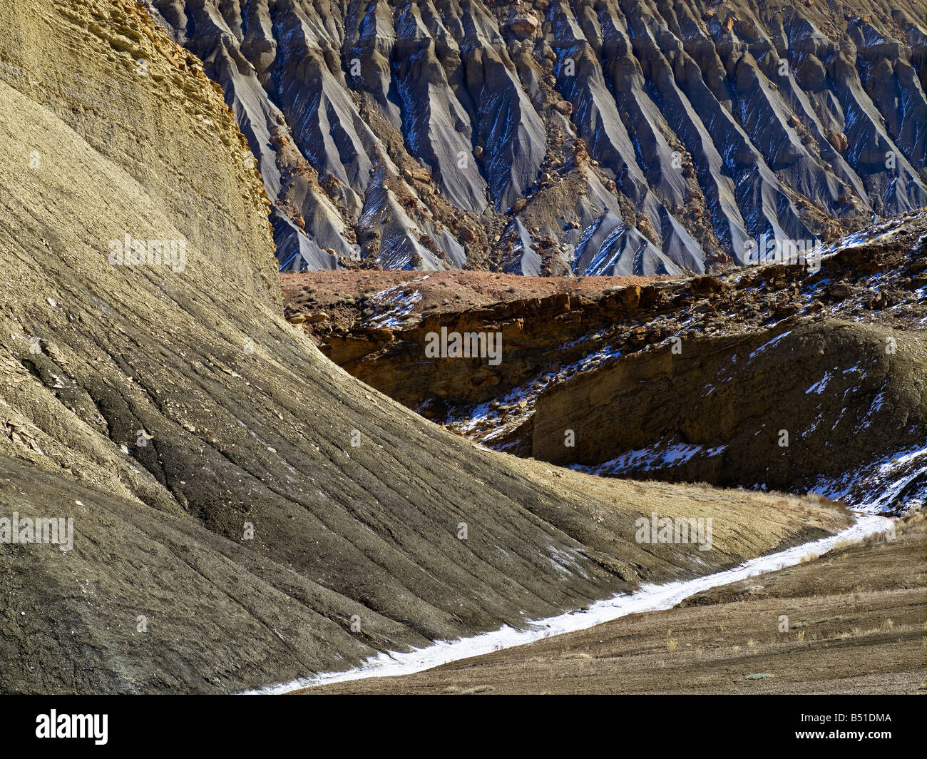 Rock cliff after snow - Stock Image