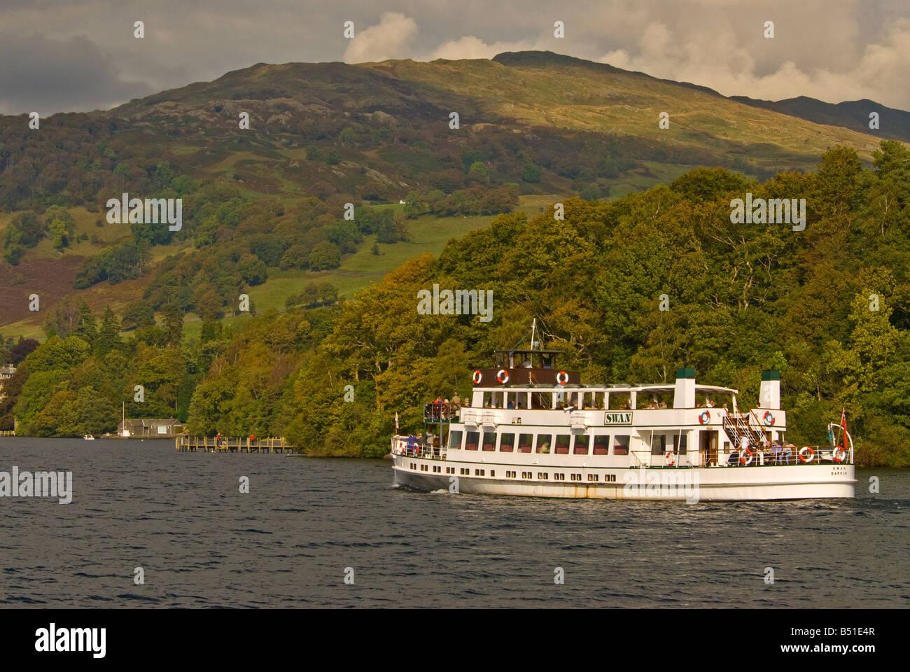 steamer Tour boat tourists Lake Windermere Lake District Cumbria UK United Kingdom fall autumn color change leaves - Stock Image