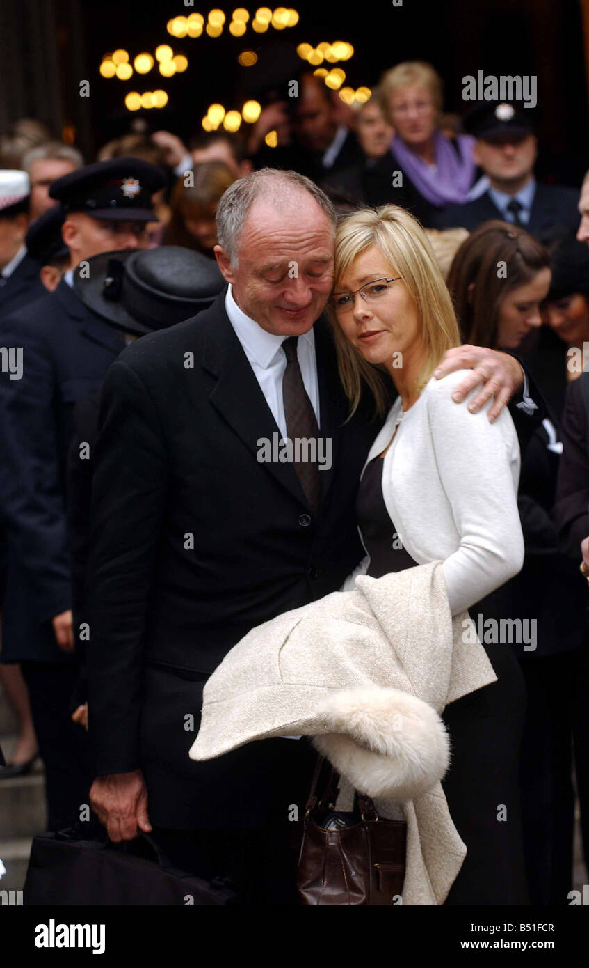 London Mayor Ken Livingstone comforts Michele the widow of Bill Faust after the memorial service for firefighters - Stock Image